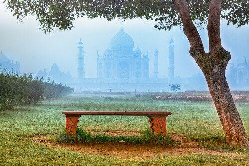 The Taj Mahal shrouded in fog, Agra.