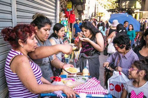 Locals sell street food on the Plaza de Armas in Santiago de Chile.