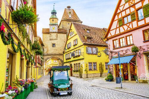 A retro car and old houses decorated for the Christmas holidays in Rothenburg ob der Tauber in Bavaria.