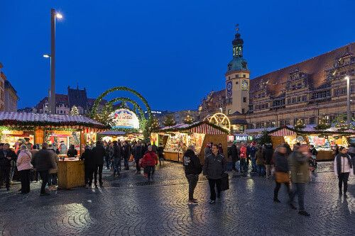 Christmas market at Marktplatz or Market square in front of the Old Town Hall at dusk in Liepzig.