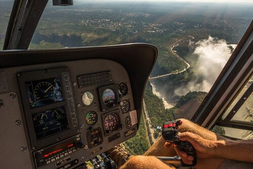 A helicopter flies over Victoria Falls.