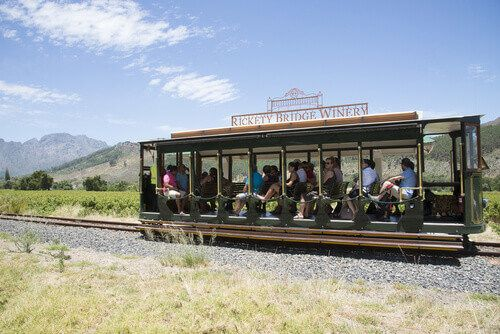 The Rickety Bridge Winery's tourist tram in the Franschhoek Valley of Western Cape, South Africa.