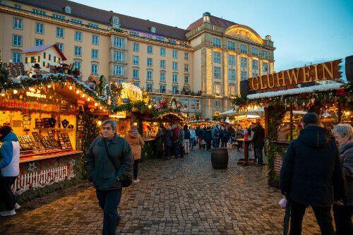 Locals and tourists visit Christmas Market Striezelmarkt in Dresden.