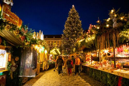 Locals visiting and buying trinkets at the Christmas Market, Striezelmarkt in Dresden.