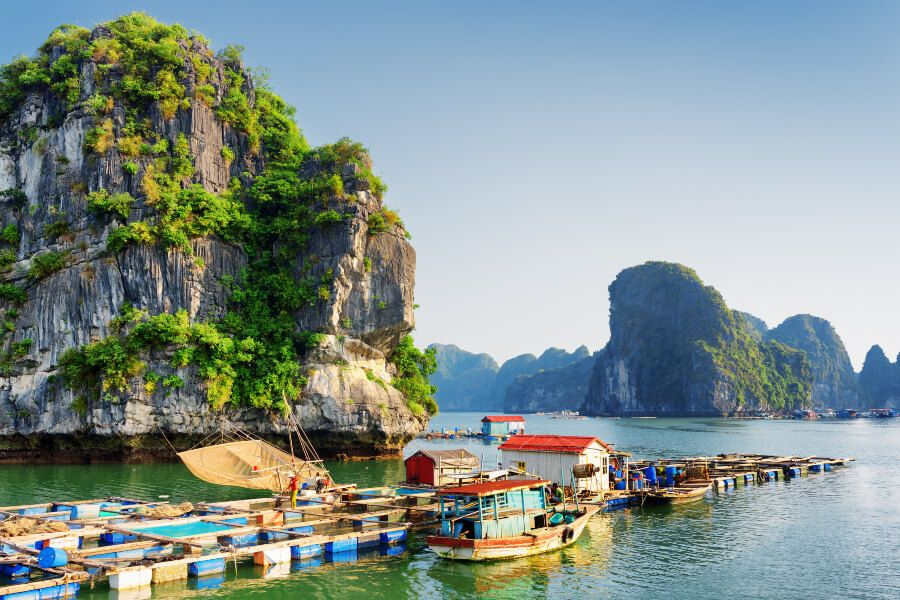 A floating fishing village in Halong Bay by the Karst Tower Isles.