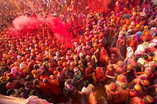 People celebrating the Holi festival in Nandgaon, Uttar Pradesh,  India.