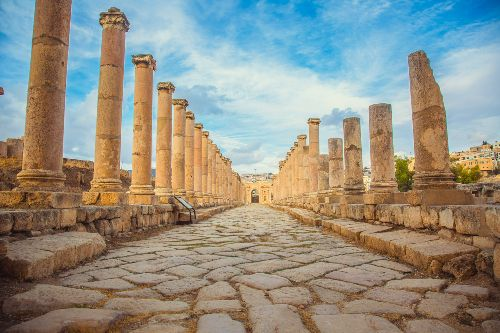 The ruins of an Ancient Roman walkway, with great columns in Jerash, Jordan.