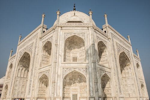 Tourists flock to the Taj Mahal each year to see the stunning marble facades.