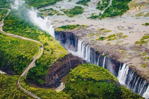 Victoria Falls or Mosi-oa-Tunya which translates to The Smoke that Thunders.