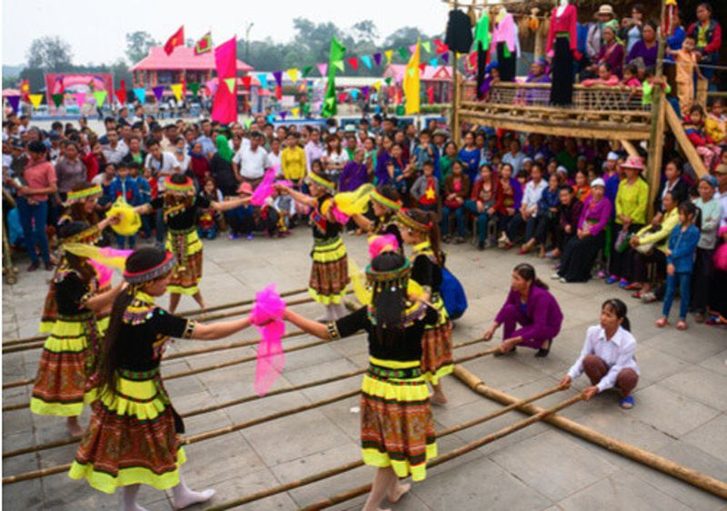 Children play folk games in the Hung King's Festival.