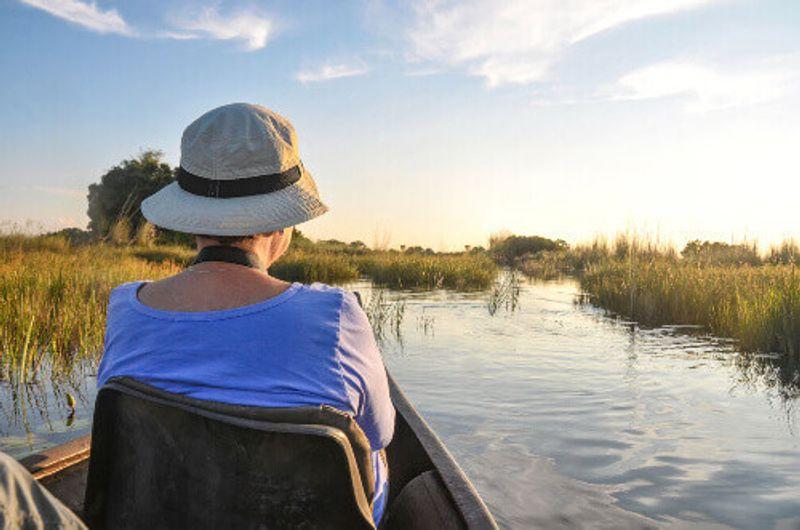 A tourist in the Mokoro Boat in the Okavango Delta.