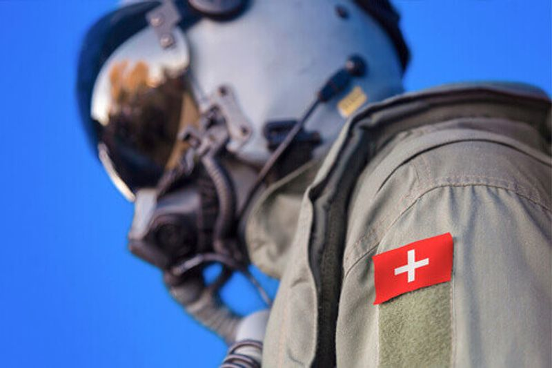 An Air Force pilot in uniform with a Switzerland flag patch in Switzerland.