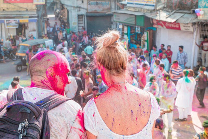 Visitors sit during the Holi Festival in India.