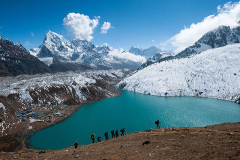 People hike alongside the Gokyo lakes region in Nepal.