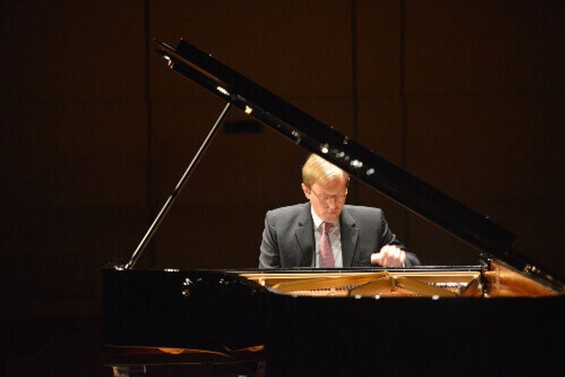 Professor Jan Jiracek von Arnim playing the piano.