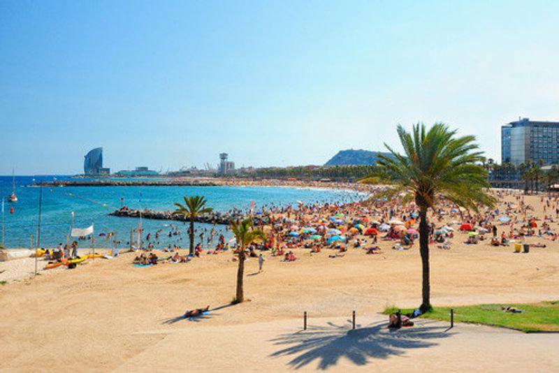 The sandy beaches of La Barceloneta Beach, Barcelona.