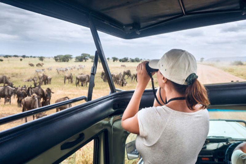 A woman enjoys the safari.