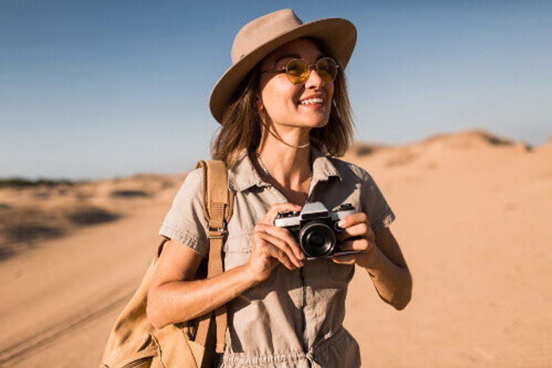 A happy tourist on a safari savannah.
