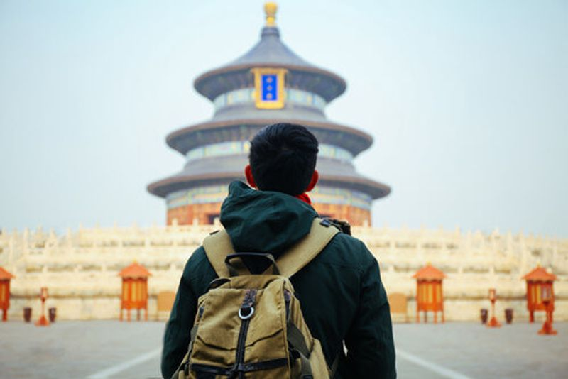 A tourist at the Temple of Heaven.
