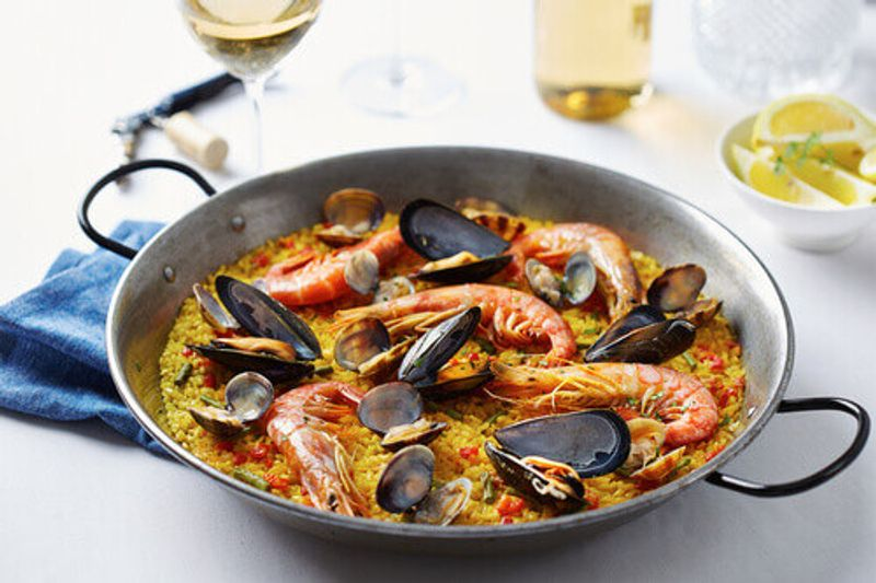 Typical spanish seafood paella served in a traditional pan in Valencia, Spain.