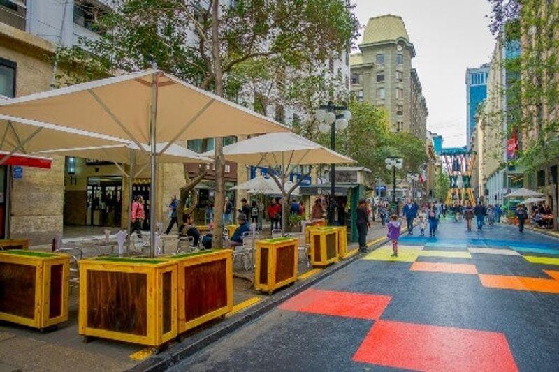 A crowd of people walking in the Plaza de las Armas square in Santiago, Chile.