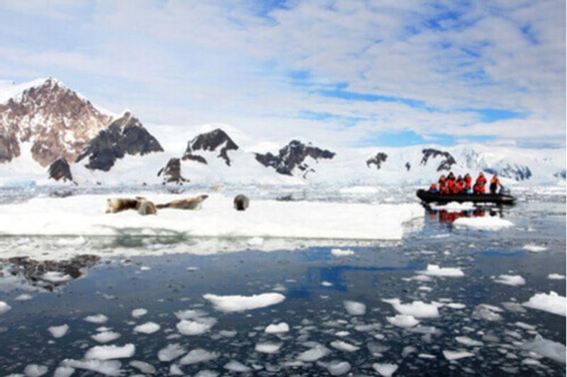 Tourists explore the area in a Zodiac.