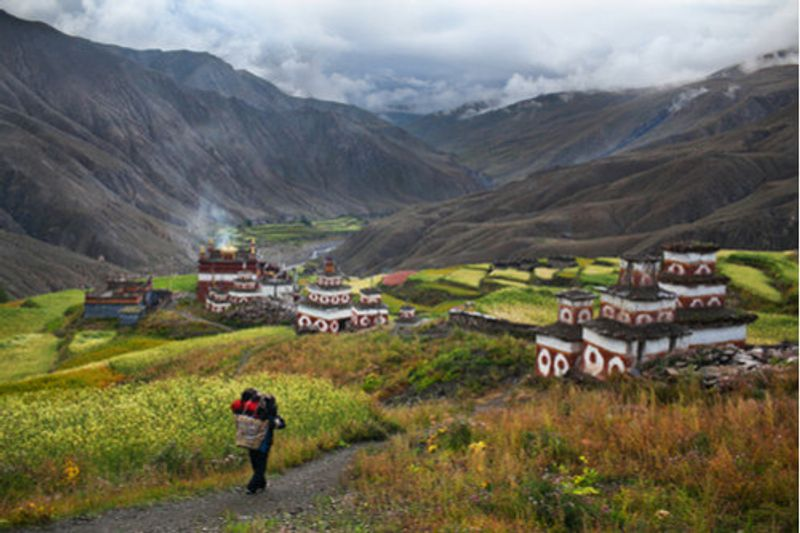 A local walks down the path to Saldang Village, Upper Dolpo.